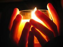 Candle_hands_prayer_5CMZMPXN